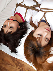 Dimdim Asian and nasty babe in t-shirts are tied in ropes on bed